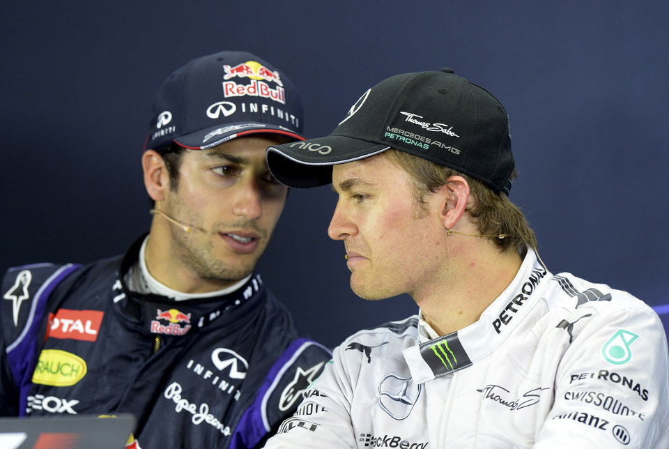 Photo - Red Bull driver Daniel Ricciardo of Australia left, and Mercedes driver Nico Rosberg of Germany chat during a press conference after the Australian Formula One Grand Prix at Albert Park in Melbourne, Australia, Sunday, March 16, 2014. Rosberg won the race and Ricciardo finished second. (AP Photo/Mal Fairclough)