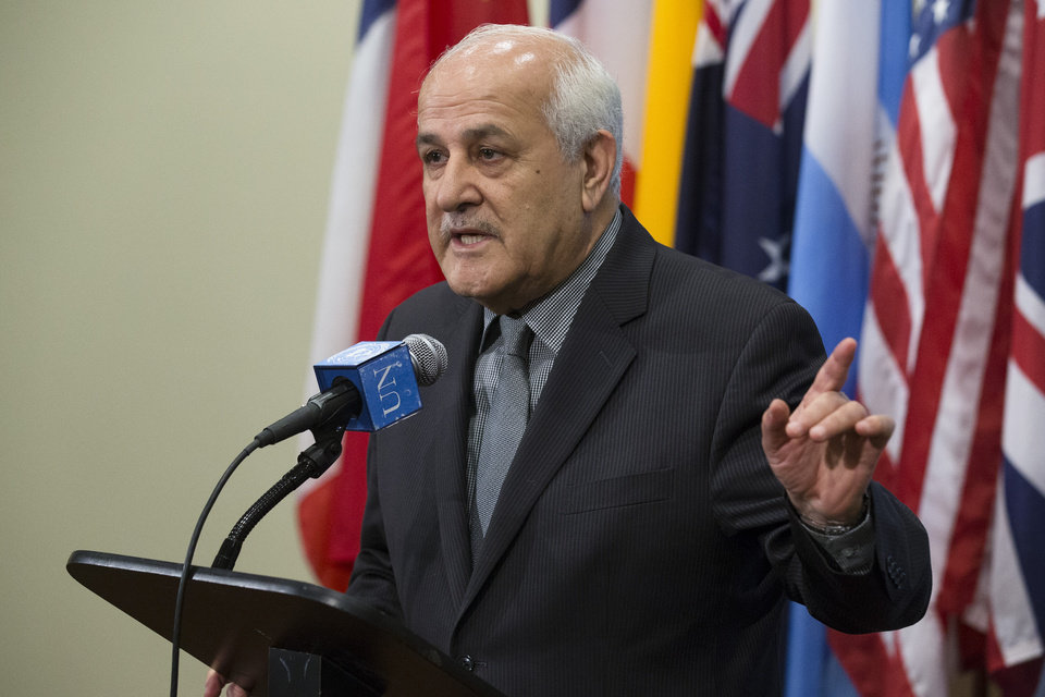 Photo - Palestinian U.N. Ambassador Riyad Mansour speaks before an emergency meeting of the U.N. Security Council at United Nations headquarters, Sunday, July 20, 2014.  A Jordan-drafted resolution obtained by The Associated Press expresses