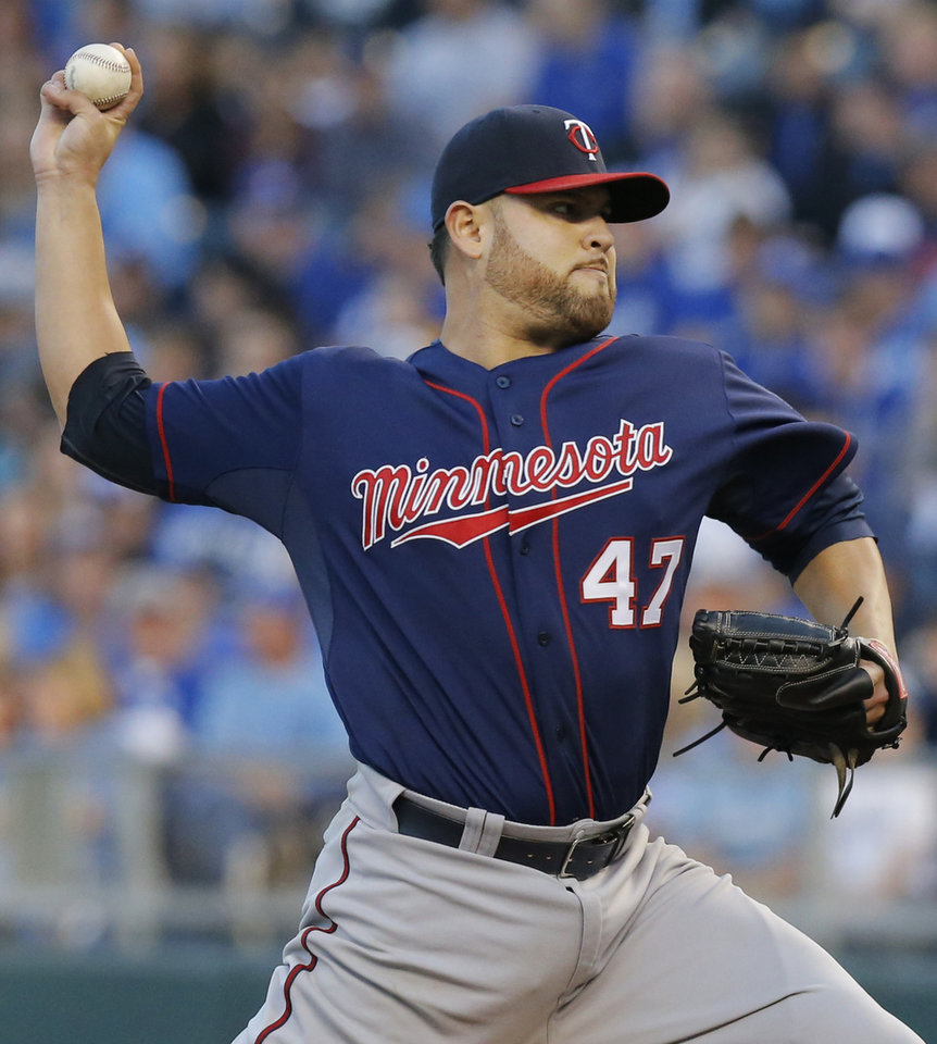 Photo - Minnesota Twins starting pitcher Ricky Nolasco (47) delivers to a Kansas City Royals batter during the first inning of a baseball game at Kauffman Stadium in Kansas City, Mo., Friday, April 18, 2014. (AP Photo/Orlin Wagner)