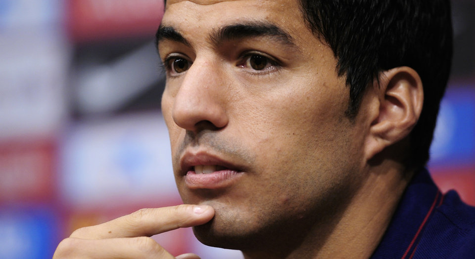 Photo - FC Barcelona's Luis Suarez, from Uruguay, attends a press conference of his presentation at the Camp Nou in Barcelona, Spain, Tuesday, Aug. 19, 2014. Barcelona unveiled Suarez on Tuesday, an event delayed for over five weeks since his transfer from Liverpool due to his latest suspension for biting an opponent at the World Cup. (AP Photo/Manu Fernandez)