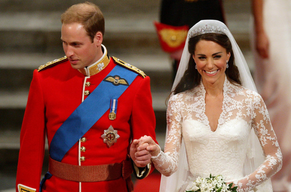 Photo - Prince William and his bride Kate, Duchess of Cambridge, leave Westminster Abbey, London, after their wedding, Friday April 29, 2011. (AP Photo/PA, Dave Thompson) UNITED KINGDOM OUT  NO SALES  NO ARCHIVE ORG XMIT: RWAJP820