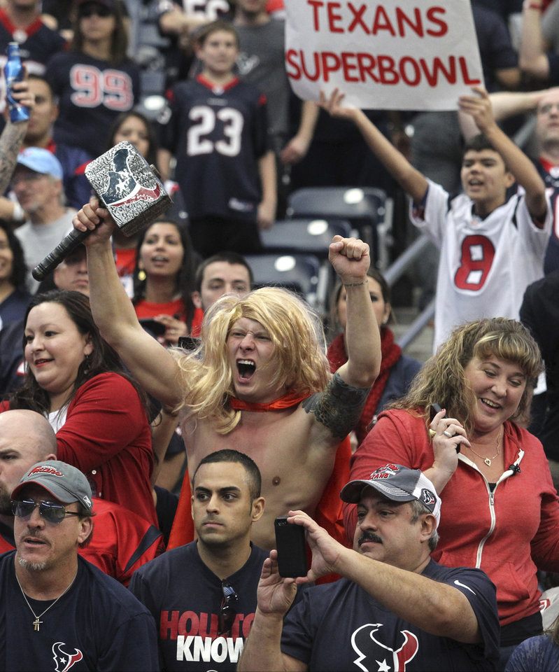 Photo -   Houston Texans fans cheer after the Texans beat the Jacksonville Jaguars 43-37 in overtime of an NFL football game Sunday, Nov. 18, 2012, in Houston. (AP Photo/Patric Schneider)
