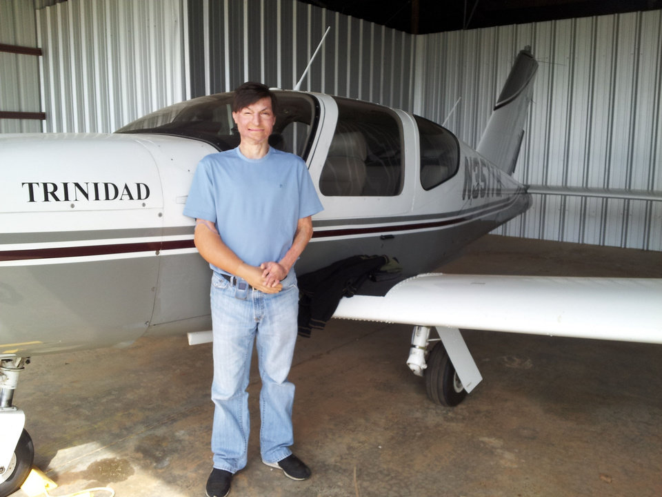 Matt Cole is shown near his plane Trinidad at the Guthrie-Edmond Regional Airport. A 2001 crash altered Cole's career path. He is now a flight instructor at the airport. Photo provided <strong></strong>