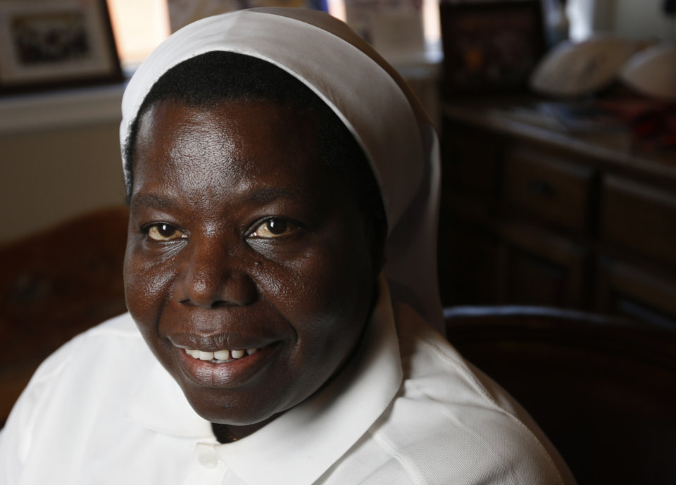 """Photo - Sister Rosemary Nyirumbe of Uganda poses for a photo at the Whitten Newman Foundation office in Oklahoma City. She's listed in Time's """"100 Most Influential People"""" issue.  Photo by Nate Billings, The Oklahoman  NATE BILLINGS -"""