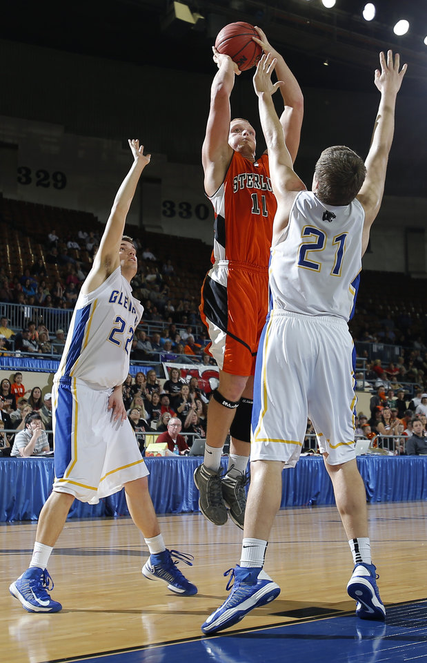 Photo - Sterling's Mickey Milam shoots in between Glencoe's Jake Lazenby, left, and Hunter Hall during the Class A boys semifinal game of the state high school basketball tournament between Glencoe and Sterling at the State Fair Arena., Friday, March 1, 2013. Photo by Sarah Phipps, The Oklahoman