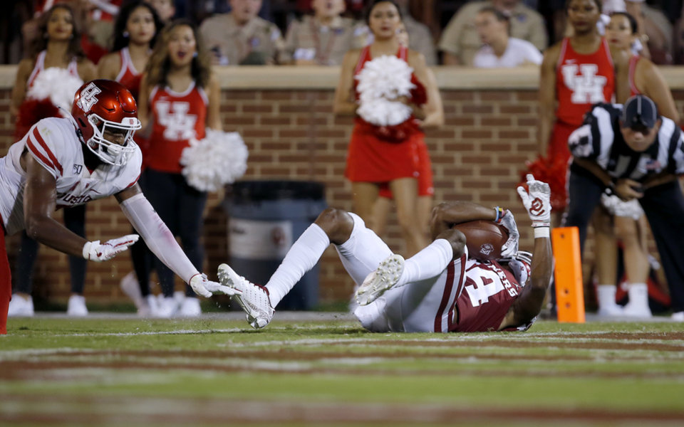 Photo - Oklahoma's Charleston Rambo (14) scores a touchdown in the third quarter during a college football game between the University of Oklahoma Sooners (OU) and the Houston Cougars at Gaylord Family-Oklahoma Memorial Stadium in Norman, Okla., Sunday, Sept. 1, 2019. [Sarah Phipps/The Oklahoman]