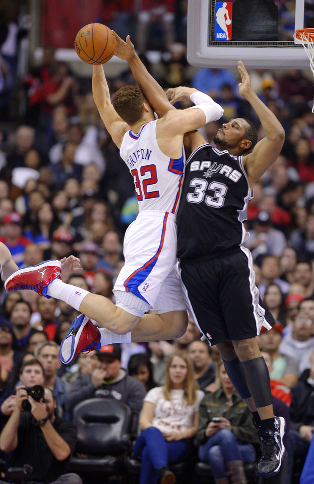 Photo - San Antonio Spurs center Boris Diaw, right, of France, blocks the shot of Los Angeles Clippers forward Blake Griffin during the first half of their NBA basketball game, Thursday, Feb. 21, 2013, in Los Angeles. (AP Photo/Mark J. Terrill)