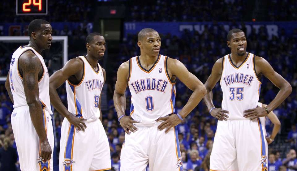 NBA BASKETBALL: Oklahoma City\'s Kendrick Perkins (5), Serge Ibaka (9, Russell Westbrook (0) and Kevin Durant (35) talk during Game 3 of the Western Conference Finals between the Oklahoma City Thunder and the San Antonio Spurs in the NBA playoffs at the Chesapeake Energy Arena in Oklahoma City, Thursday, May 31, 2012. Photo by Sarah Phipps, The Oklahoman