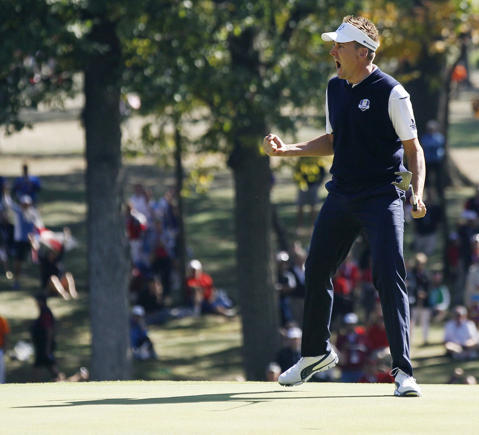 Photo - Europe's Ian Poulter reacts after making a putt on the 12th hole during a singles match at the Ryder Cup PGA golf tournament Sunday, Sept. 30, 2012, at the Medinah Country Club in Medinah, Ill. (AP Photo/Charles Rex Arbogast)  ORG XMIT: PGA148