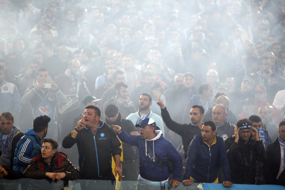 Photo - Napoli's supporters shout before the Italian Cup final soccer match between Fiorentina and Napoli Rome's Olympic stadium, Saturday, May 3, 2014. At least one fan and one police officer were reportedly shot before the Italian Cup final between Napoli and Fiorentina, and the fan was in serious condition. As a result, the start of the final was delayed, and there were scenes of violence inside the stadium with a firefighter injured by fireworks thrown from the stands. The shootings occurred in an area where Napoli fans were gathering for the match, the ANSA news agency reported. (AP Photo/Alessandra Tarantino)