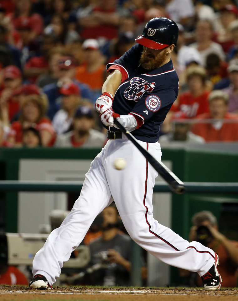 Photo - Washington Nationals' Adam LaRoche hits an RBI single during the third inning of a baseball game against the Pittsburgh Pirates at Nationals Park, Friday, Aug. 15, 2014, in Washington. The Nationals won 5-4. (AP Photo/Alex Brandon)