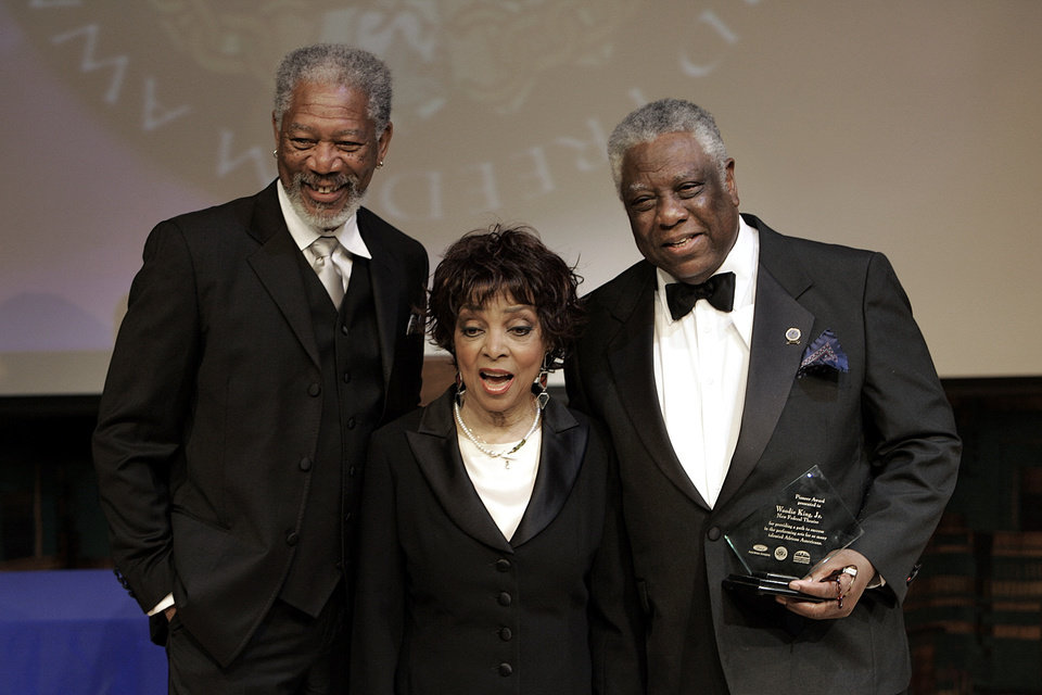 Photo - FILE - In this May 15, 2006 file photo shows actors Morgan Freeman, from left, Ruby Dee, accepting for her husband Ossie Davis, awarded the 2006 Ford Freedom Award posthumously, and director Woodie King, Jr., after being honored as the 2006 Ford Freedom Award winners in Detroit.  Dee, an acclaimed actor and civil rights activist whose versatile career spanned stage, radio television and film, has died at age 91, according to her daughter. Nora Davis Day told The Associated Press on Thursday, June 11, 2014, that her mother died at home at New Rochelle, New York, on Wednesday night.  (AP Photo/Paul Sancya, file)