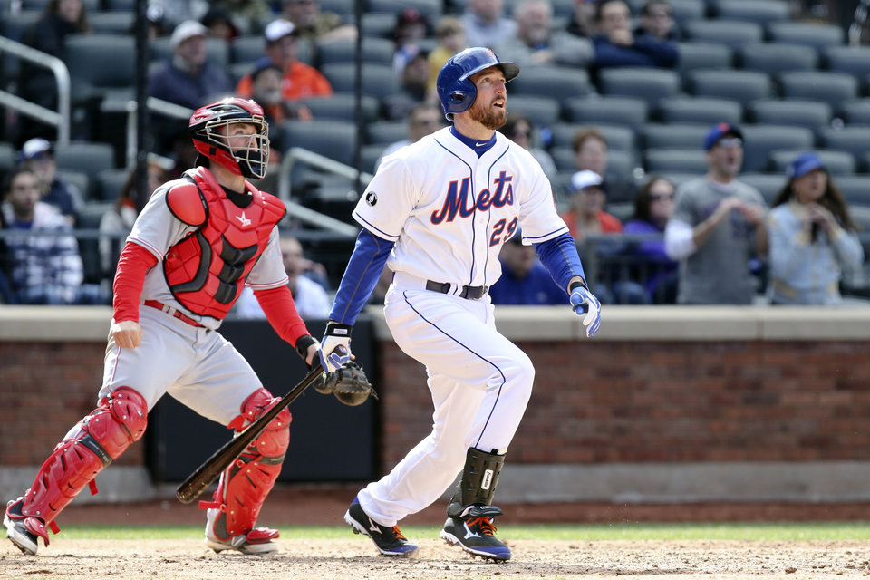 Photo - New York Mets first baseman Ike Davis (29) hits a walk-off grand slam in the ninth inning of a baseball game against the Cincinnati Reds at Citi Field, Saturday, April 5, 2014, in New York. The Mets won 6-3. (AP Photo/John Minchillo)