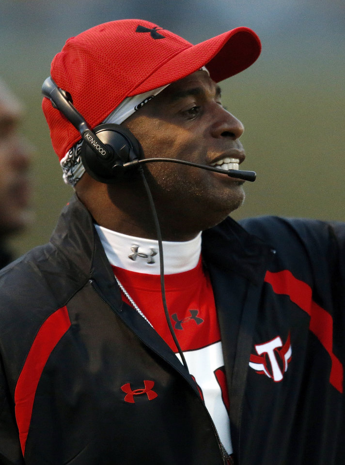 Prime Prep coach Deion Sanders gives instructions to his players during a high school football game between Millwood and Prime Prep Academy in Oklahoma City, Friday, Sept. 14, 2012. Photo by Nate Billings, The Oklahoman