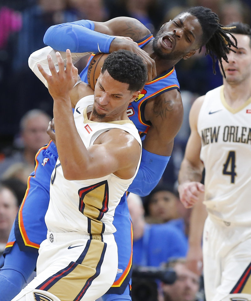 Photo - Oklahoma City's Nerlens Noel (9) fights for the ball with New Orleans' Josh Hart (3) during an NBA basketball game between the Oklahoma City Thunder and the New Orleans Pelicans at Chesapeake Energy Arena in Oklahoma City, Saturday, Nov. 2, 2019. Oklahoma City won 115-104. [Bryan Terry/The Oklahoman]