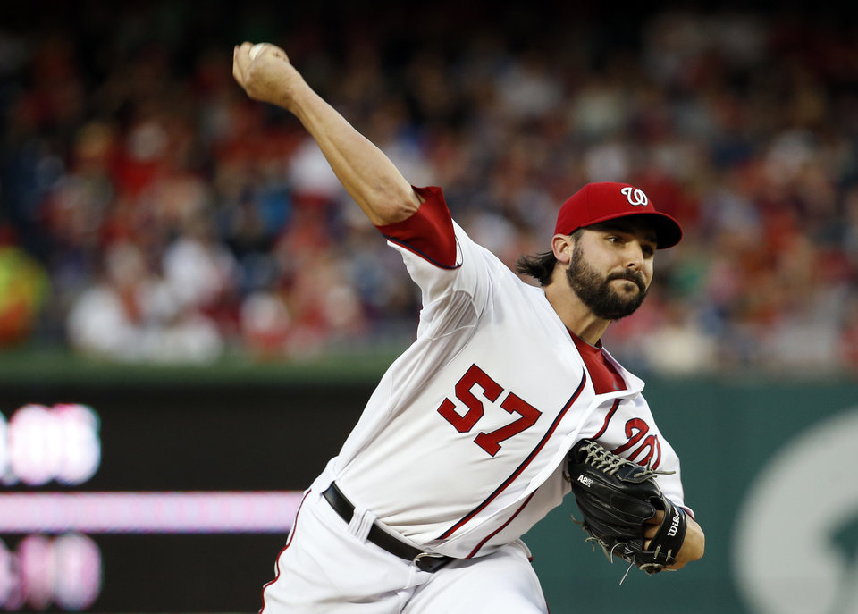 Washington Nationals starting pitcher Tanner Roark  throws during the third inning of a baseball game against the New York Mets at Nationals Park Friday, May 16, 2014, in Washington. (AP Photo/Alex Brandon)