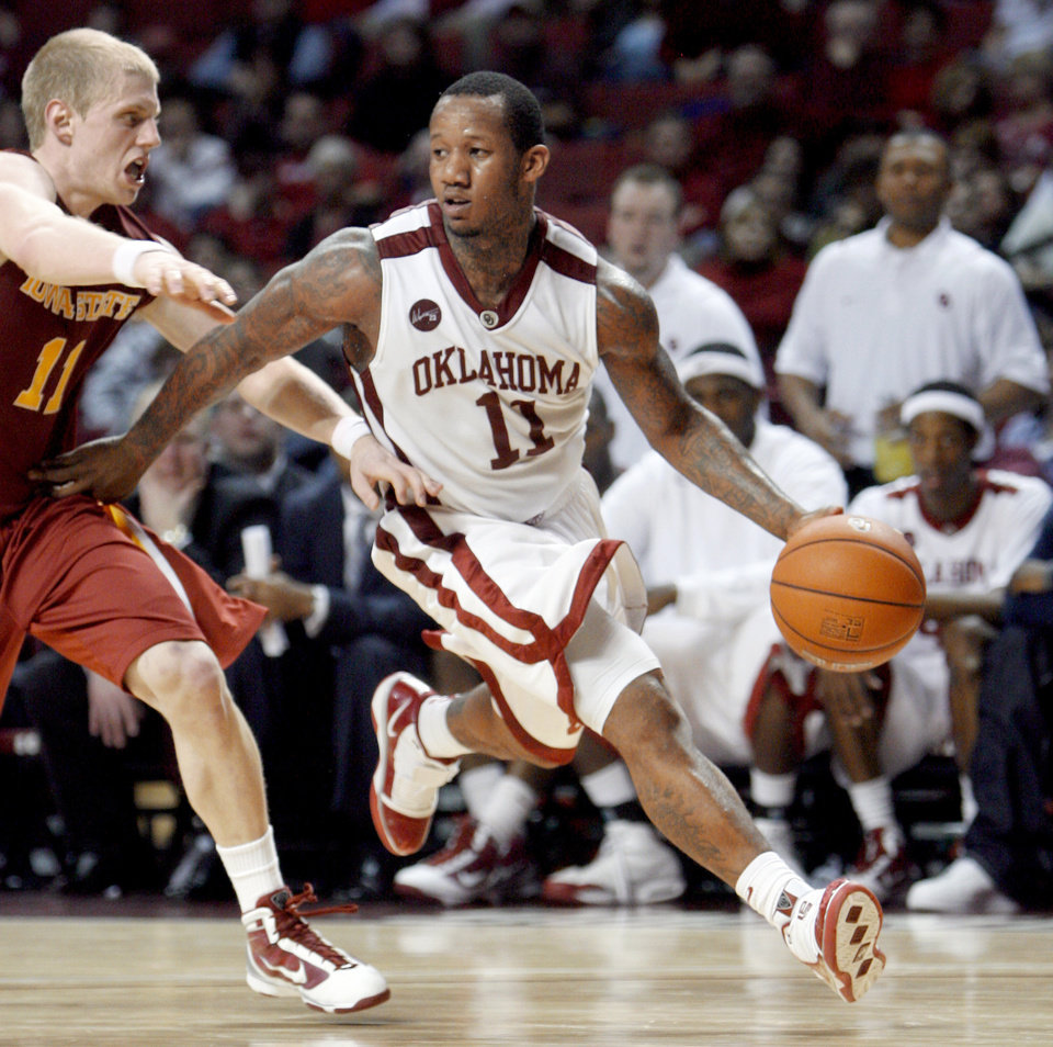 Photo - OU's Tommy Mason-Griffin, right, drives past Iowa State's Scott Christopherson on his way to a 38-point performance on Wednesday night.  Photo by Sarah Phipps, The Oklahoman.