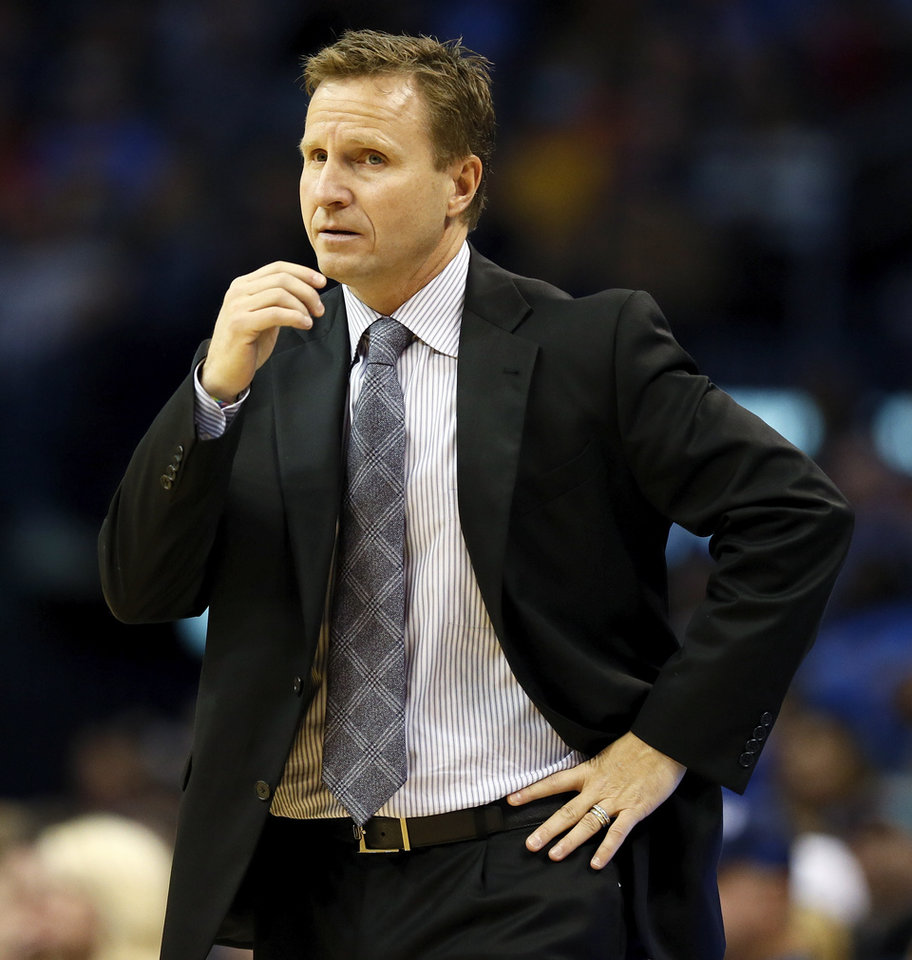 Oklahoma City's Scott Brooks coached from the bench area during an NBA basketball game between the Oklahoma City Thunder and the San Antonio Spurs at Chesapeake Energy Arena in Oklahoma City, Wednesday, Nov. 27, 2013. Oklahoma City won, 94-88. Photo by Nate Billings, The Oklahoman