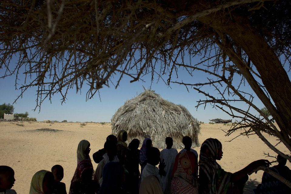 In this Nov. 2, 2012 photo, children gather under a sole shade tree as they take a break from class outside their schoolhouse made of reeds in the village of Louri, in the Mao region of Chad. A survey conducted in the country found that 51.9 percent of the children are stunted, one of the highest rates in the world, according to a summary published by UNICEF. Stunting is the result of having either too few calories, too little variety, or both. The struggle that is on display every day in the village's one-room schoolhouse reveals not only the staggering price that these children are paying, but also the price that it has exacted from Africa. (AP Photo/Rebecca Blackwell) ORG XMIT: NY875