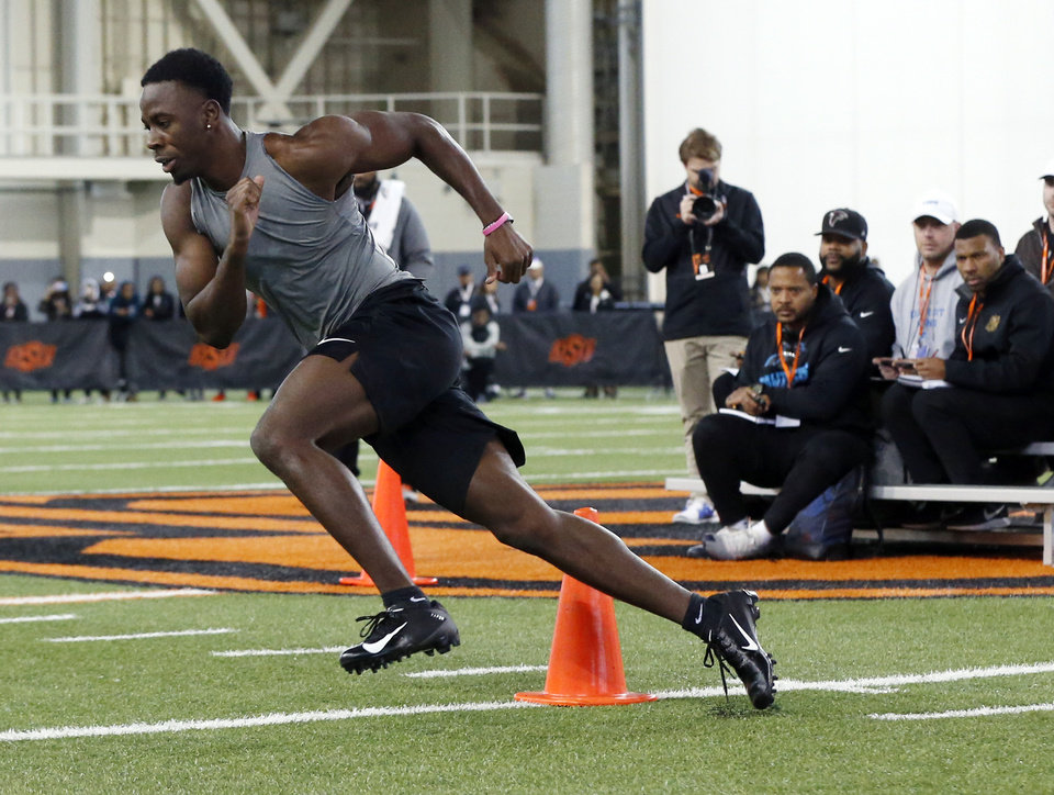 Photo - Oklahoma State cornerback A.J. Green runs a drill during OSU Pro Day inside the Sherman E. Smith Training Center in Stillwater, Okla., Tuesday, March 10, 2020. [Nate Billings/The Oklahoman]