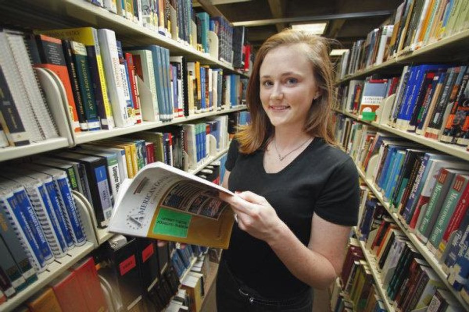 Photo - University of Oklahoma student Lindsay Green poses in the text book reserve area of the University's library on Friday, July 22, 2011, in Norman, Okla.   Photo by Steve Sisney, The Oklahoman ORG XMIT: KOD