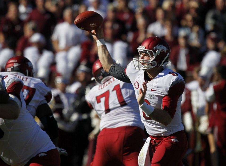 Photo -   Arkansas quarterback Tyler Wilson (8) throws a pass against Mississippi State in the second quarter of their NCAA college football game in Starkville, Miss., Saturday, Nov. 17, 2012. (AP Photo/Rogelio V. Solis)