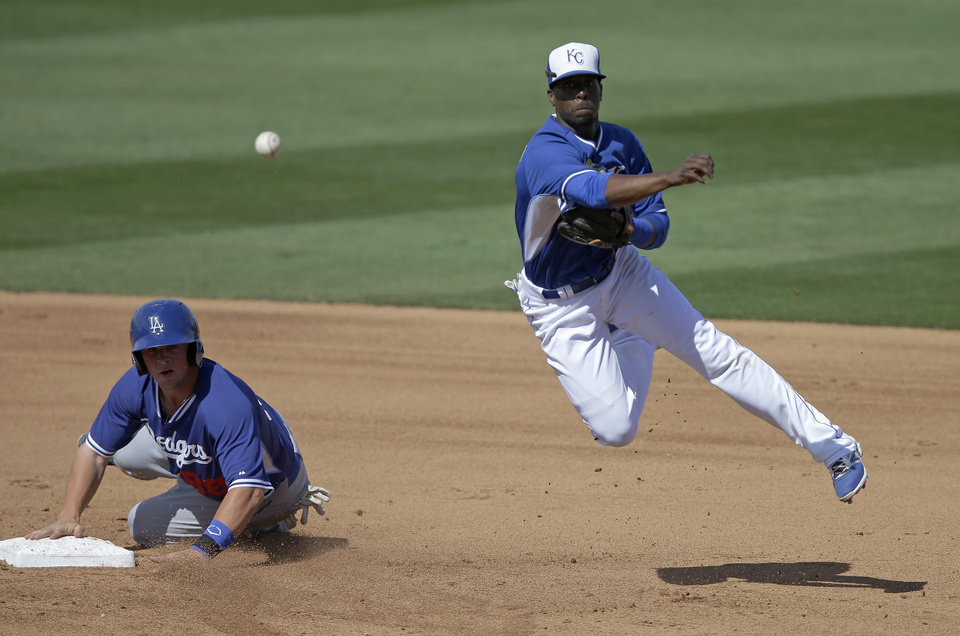 Photo - Los Angeles Dodgers' Kyle Farmer is forced out at second as Kansas City Royals's Pedro Ciriaco throws to first during the fifth inning of a spring exhibition baseball game Tuesday, March 11, 2014, in Surprise, Ariz. (AP Photo/Darron Cummings)