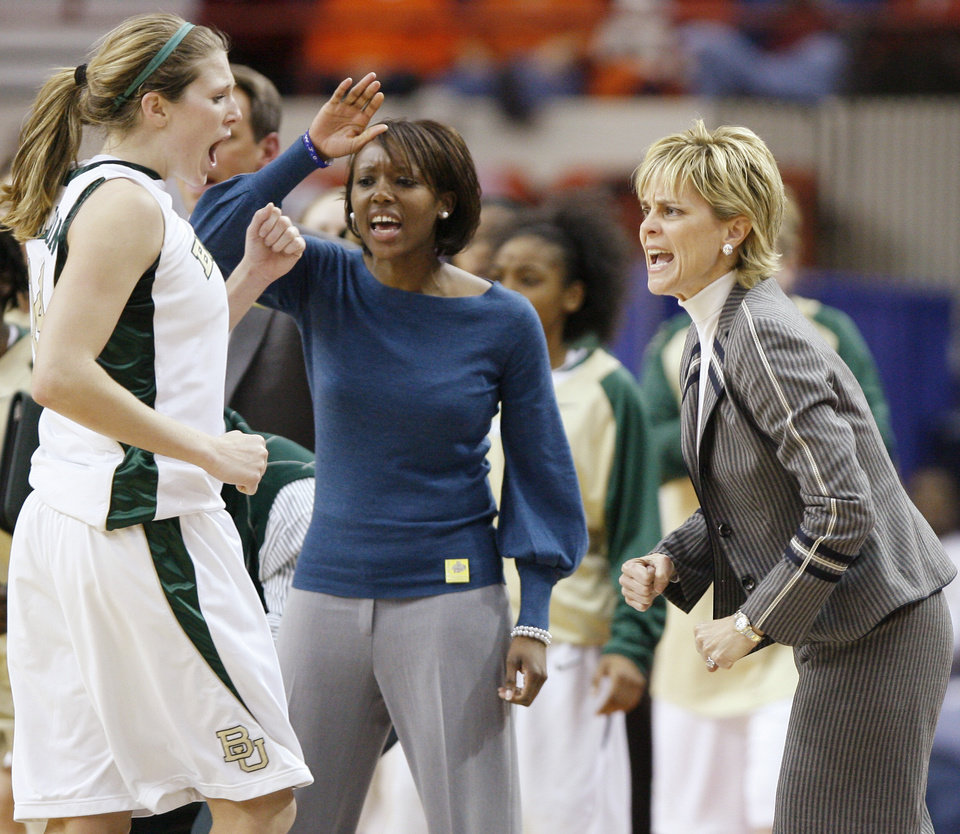 Photo - Rachel Allison, left, Rekha Patterson, and coach Kim Mulkey celebrate during the Big 12 Women's Championship game between Oklahoma State and Baylor at the Cox Center in Oklahoma City, Friday, March 13, 2009.  OSU lost to Baylor 67-62. PHOTO BY BRYAN TERRY, THE OKLAHOMAN
