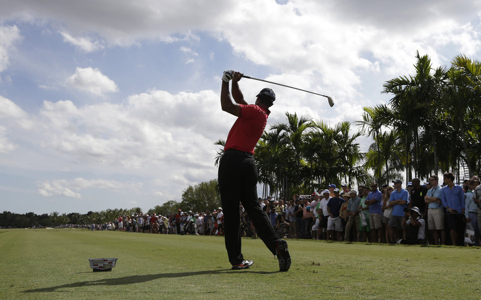Photo - Tiger Woods hits from the sixth tee during the final round of the Cadillac Championship golf tournament on Sunday, March 9, 2014, in Doral, Fla. (AP Photo/Lynne Sladky)