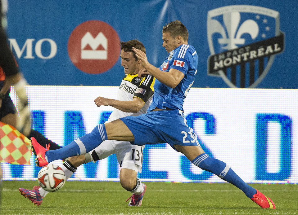 Photo - Montreal Impact's Krzysztof Krol, right, and Columbus Crew's Ethan Finlay battle for the ball during first half MLS soccer action in Montreal, Saturday, Aug. 30, 2014. (AP Photo/The Canadian Press, Graham Hughes)