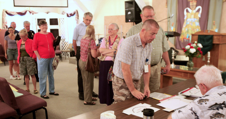 Photo - Voters line up at precinct 460, 3106 N. Utah, in northwest Oklahoma City Tuesday, July 27, 2010. Photo by Paul B. Southerland, The Oklahoman