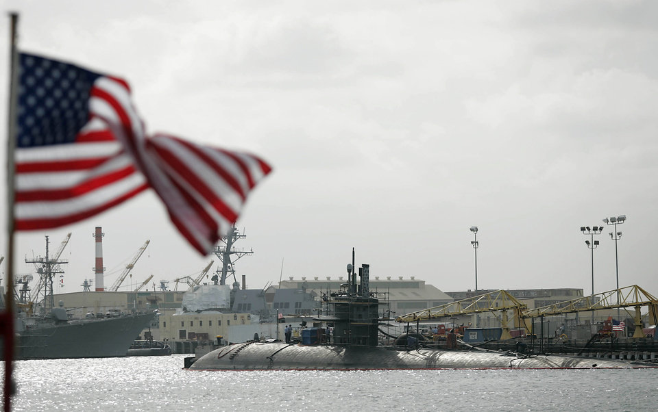 FILE - The USS Honolulu is shown docked at Pearl Harbor in Honolulu in this Feb. 27, 2006 file photo. Spying isn't new to Hawaii, with Pearl Harbor and other island facilities, since before the attack on Pearl Harbor on Dec. 7, 1941, being ripe targets for spying by adversaries of the U.S. (AP Photo/Marco Garcia)