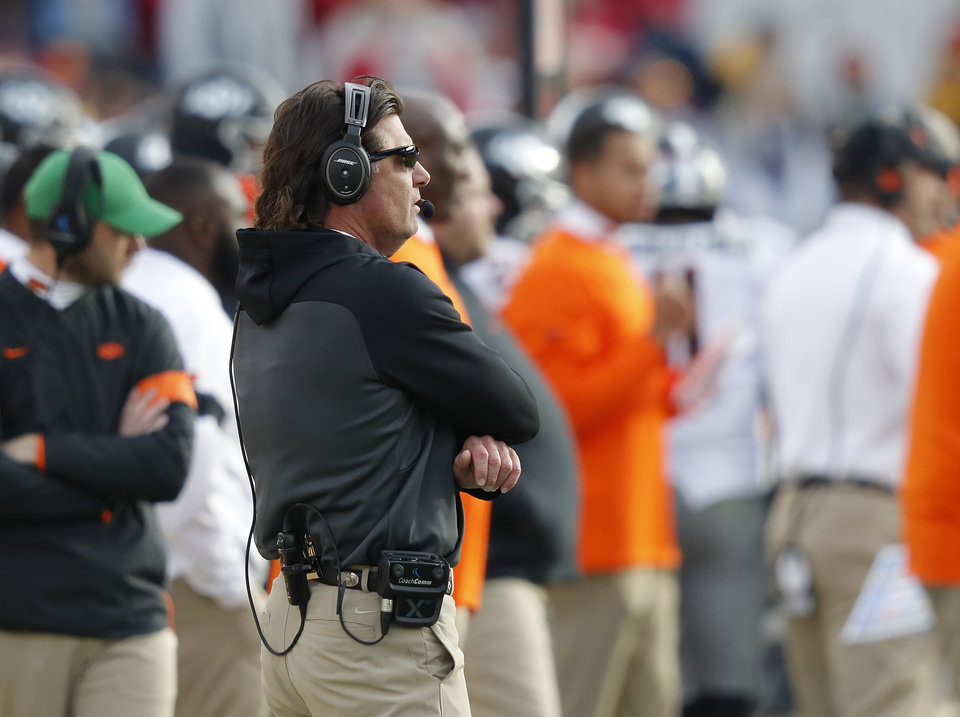Photo - Oklahoma State head coach Mike Gundy watches from the sidelines during the second half of an NCAA college football game against Iowa State, Saturday, Oct. 26, 2019, in Ames, Iowa. Oklahoma State won 34-27. (AP Photo/Matthew Putney)