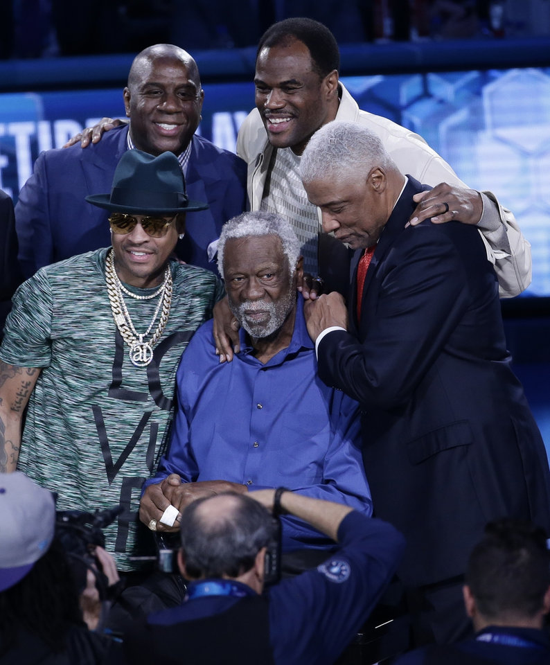 "Photo - NBA greats, from left, Allen Iverson, Magic Johnson, David Robinson, and Julius ""Dr. J"" Erving, surround Bill Russell, center, during festivities at the NBA All-Star basketball game, Sunday, Feb. 17, 2019, in Charlotte, N.C. (AP Photo/Gerry Broome)"