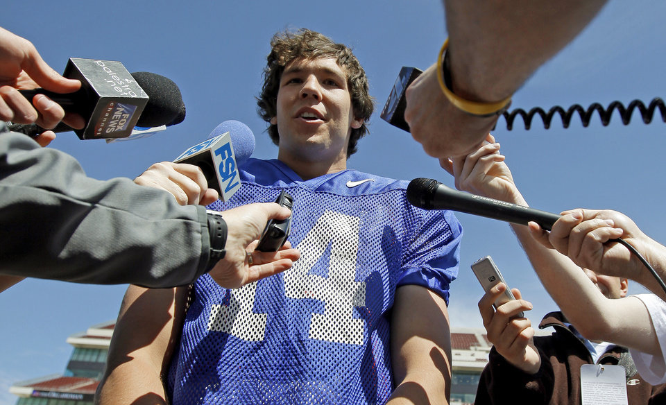 Photo - OU's Sam Bradford talks to the media after Oklahoma's Red-White football game at The Gaylord Family - Oklahoma Memorial Stadiumin Norman, Okla., Saturday, April 11, 2009. Photo by Bryan Terry, The Oklahoman