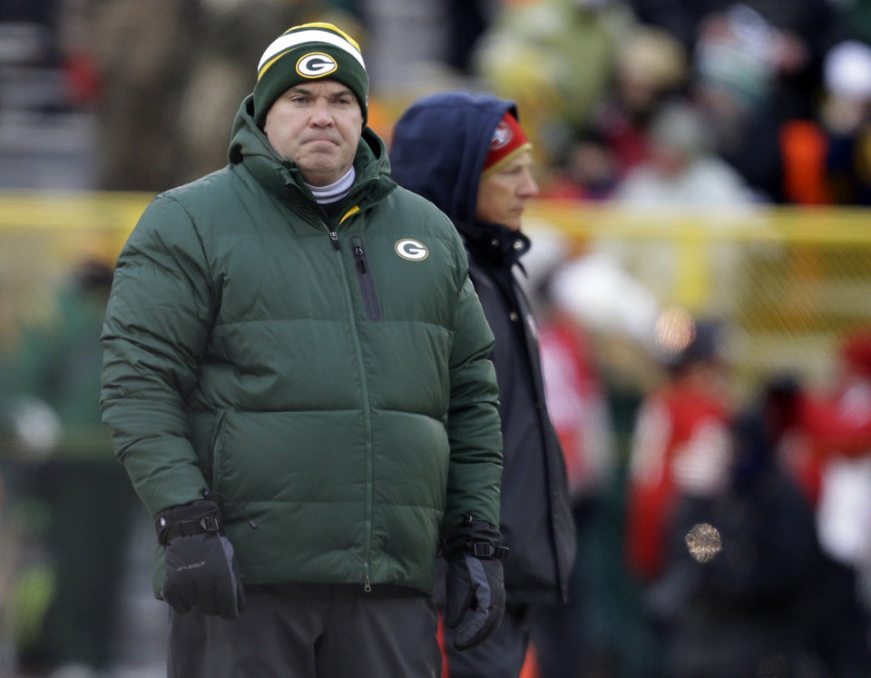 Photo - Green Bay Packers head coach Mike McCarthy watches warm ups before an NFL wild-card playoff football game against the San Francisco 49ers, Sunday, Jan. 5, 2014, in Green Bay, Wis. (AP Photo/Mike Roemer)