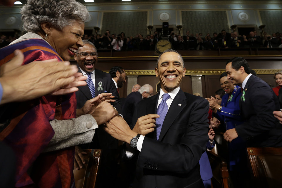 President Barack Obama is greeted before his State of the Union address during a joint session of Congress on Capitol Hill in Washington, Tuesday Feb. 12, 2013. (AP Photo/Charles Dharapak, Pool) ORG XMIT: CAP510