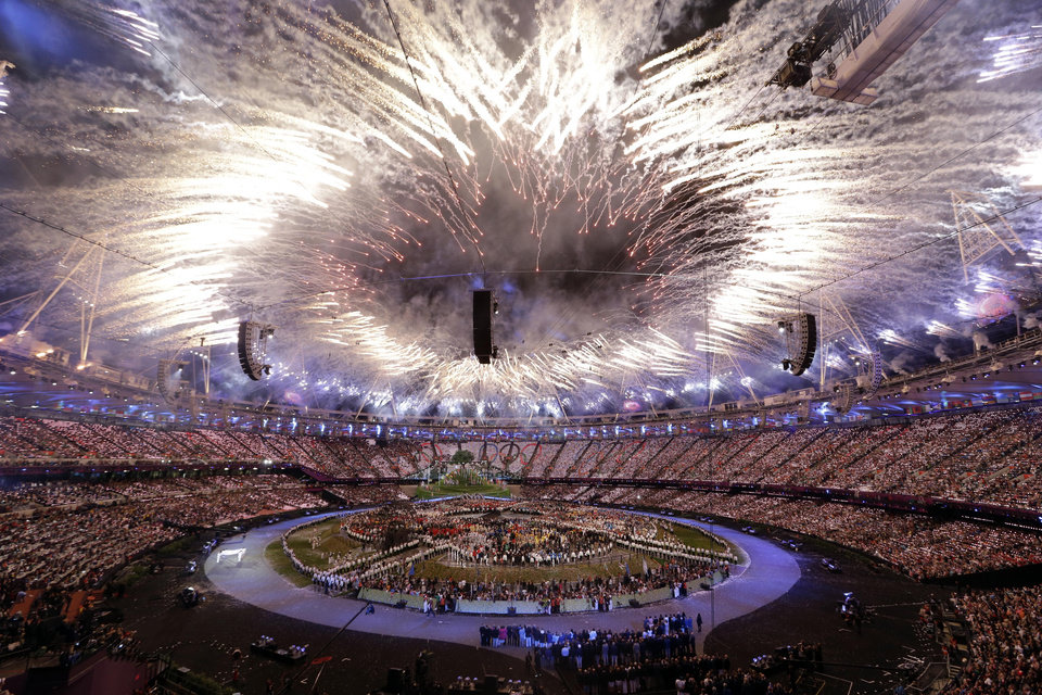 "FILE - In this Friday, July 27, 2012, file photo, fireworks explode during the Opening Ceremony at the 2012 Summer Olympics, in London. In Google's 12th annual roundup of global trending searches, ""Olympics 2012"" was ranked at seventh. (AP Photo/Paul Sancya)"