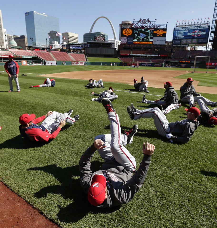 Players for the Washington Nationals stretch before Game 1 of the National League division baseball series against the St. Louis Cardinals Sunday, Oct. 7, 2012, in St. Louis. (AP Photo/Charlie Riedel)