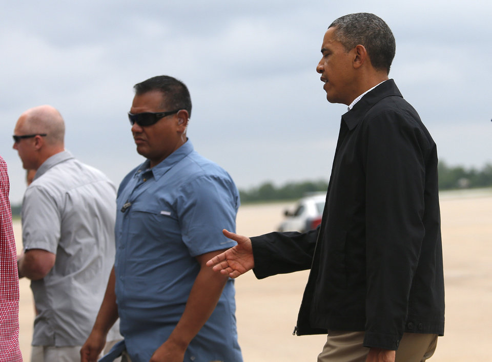 Photo - President Barack Obama walks to greet guests at Tinker Air Force base in Midwest City, Sunday, May 26, 2013. Obama was in town to visit areas damaged by the May 20 tornado. Photo by Sarah Phipps, The Oklahoman