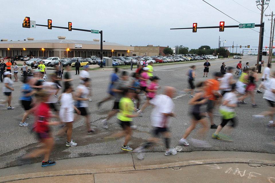 Participants run during the twelfth annual Oklahoma City Memorial Marathon in Oklahoma City, Sunday, April 29, 2012.  Photo by Garett Fisbeck, For The Oklahoman