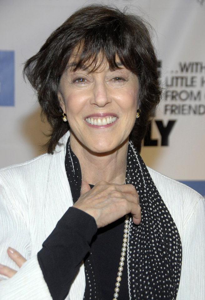 Photo -   FILE - In this Dec. 2, 2008 file photo, director Nora Ephron poses on the press line at