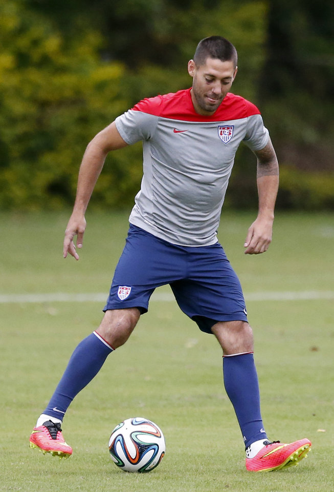 Photo - United States' Clint Dempsey works out during a training session in Sao Paulo, Brazil, Thursday, June 19, 2014.  The United States will play against Portugal in group G of the 2014 soccer World Cup on June 22. (AP Photo/Julio Cortez)