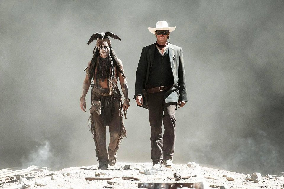 Photo - From left, Johnny Depp and Armie Hammer star in