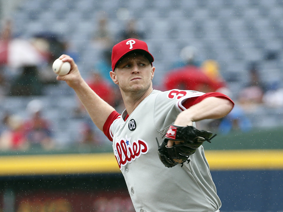 Photo - Philadelphia Phillies starting pitcher Kyle Kendrick works in the first inning of a baseball game  against the Atlanta Braves in Atlanta, Sunday, July 20, 2014.(AP Photo/John Bazemore)