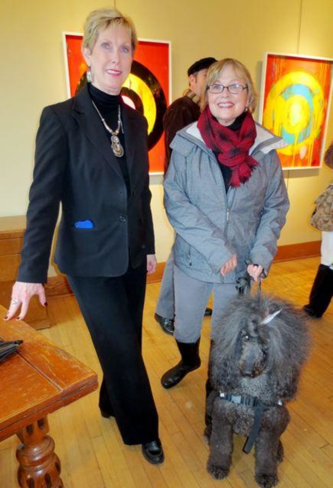 Carolyn Stuart and Judy Savage with her dog Rossi were at the annual black-eyed pea New Year�s Brunch was held at the JRB Art at the Elms Gallery.  Guests checked out the artwork of Ford Beckman in the Main Gallery while enjoying champagne, mimosas and bloody marys.   Judy Savage brought Rossi, her standard poodle. She has just written a book about the therapy dog and it was available in the Art Gallery. (Photo by Helen Ford Wallace).