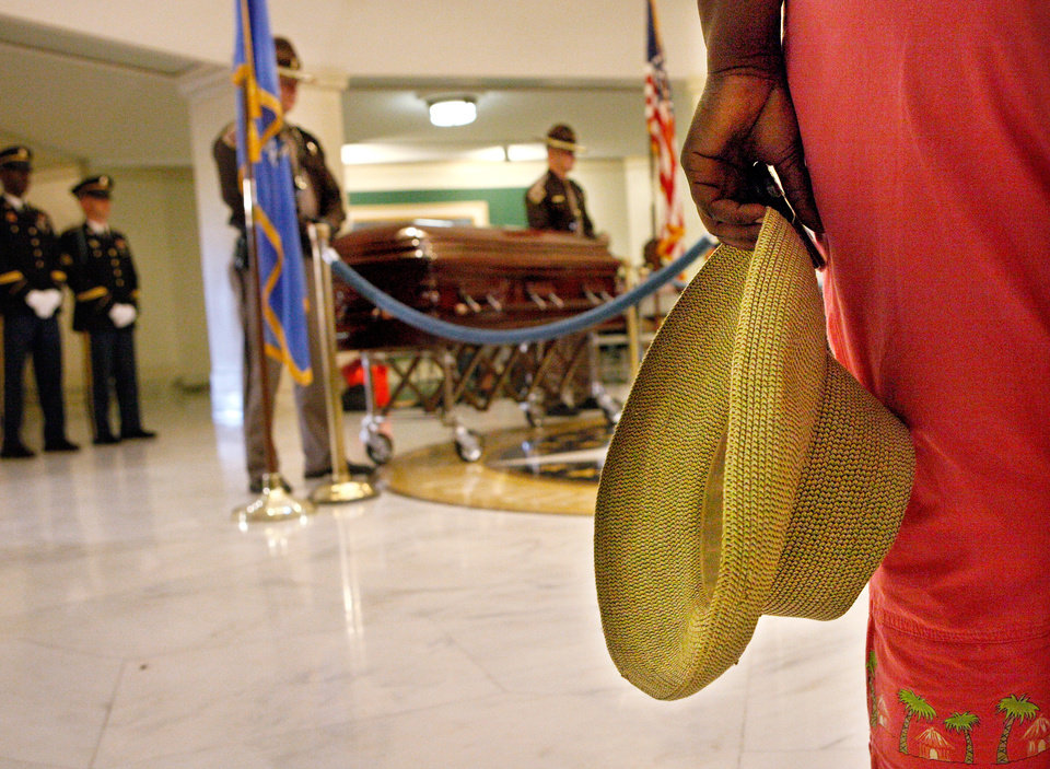 Photo - A woman holds her hat against her side as she pauses to view Clara Luper's casket.  Oklahoma civil rights leader  Clara Luper was honored by the state as her body lay in repose on the first floor of the State Capitol, Thursday, June 16, 2011. Her dark wood casket remained closed as a pair of Oklahoma Highway Patrol troopers stood silently on either side of the casket. Luper died in Oklahoma City last week. Photo by Jim Beckel, The Oklahoman