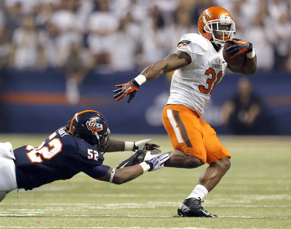 Photo - Oklahoma State's Jeremy Smith (31) gets by UTSA's Blake Terry during the first half of a college football game between the University of Texas at San Antonio Roadrunners (UTSA) and the Oklahoma State University Cowboys (OSU) at the Alamodome in San Antonio, Saturday, Sept. 7, 2013.  Photo by Sarah Phipps, The Oklahoman