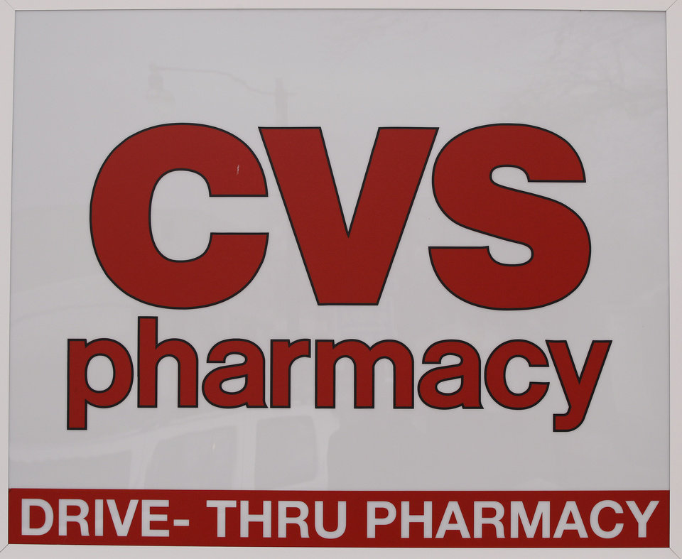 A CVS pharmacy sign is displayed outside a store in Foxborough, Mass., Feb. 7, 2012. CVS Caremark said Wednesday, Feb. 8, 2012, its fourth-quarter earnings climbed nearly 4 percent, as the drugstore operator�s pharmacy services revenue swelled due to a long-term contract and new business. (AP Photo/Stephan Savoia)