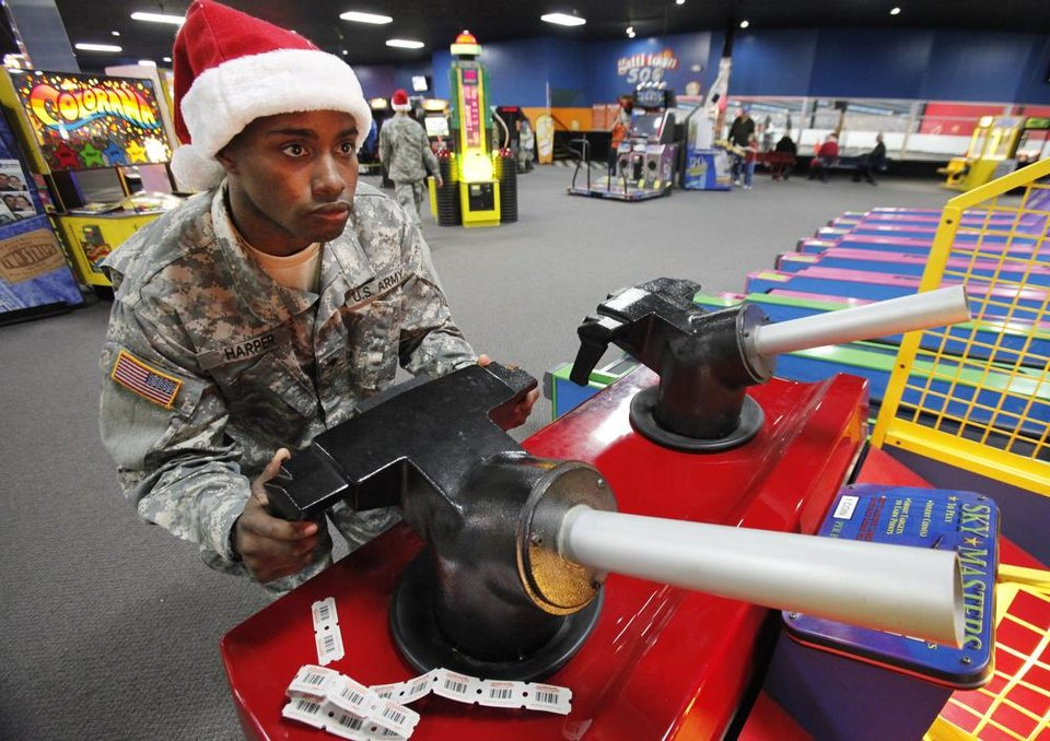 New recruit Harvey Harper plays a game were he shoots balls into a target with a cannon during a lunch stop at Gatti Town during Soldiers Day Out, Friday, December 21, 2012. Edmond/North OKC Blue Star Mothers will be taking the soldiers who can't go home for Christmas around the metro for a day of fun. Photo By David McDaniel/The Oklahoman